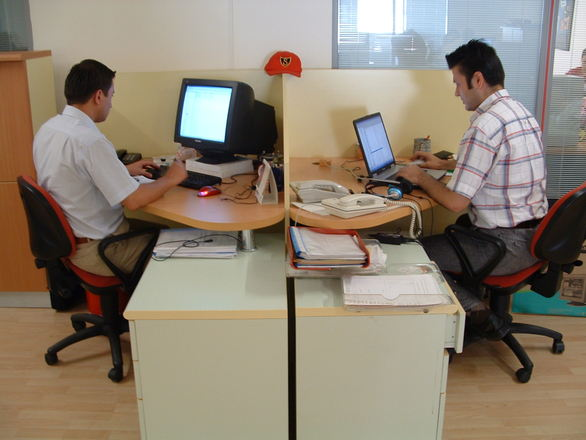two office workers on computer