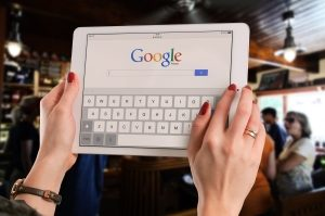 Woman using Google on an iPad
