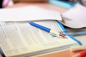 Study table with finance book and pen