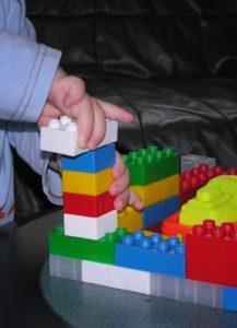 Someone building with Lego bricks