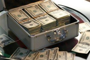$100 bills in a case