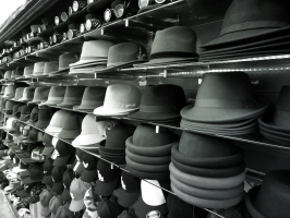 Black, white, and grey hats